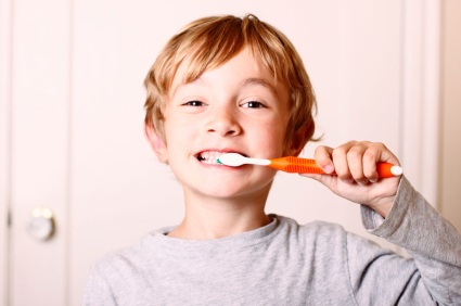 Ann Arbor, MI boy brushing his teeth before visiting the dentist.