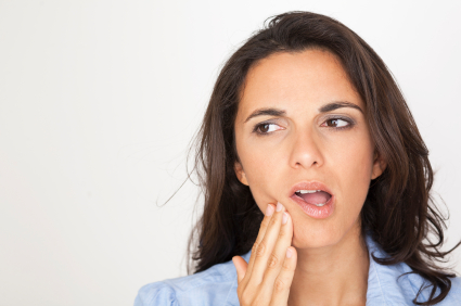 Woman in need of gum disease treatment in Ann Arbor, MI.